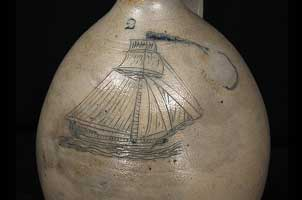 stoneware jug incised with schooner
