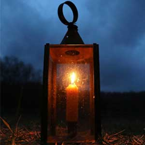 Photograph of lighted lantern at night