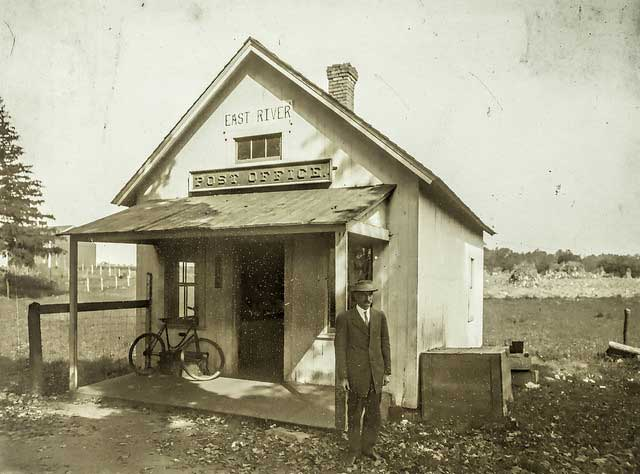 From before 1871 to 1959, Madison's East River District had its own post office in a small, red building on the Post Road. The building was sold and moved nearby for reuse as a real estate office.