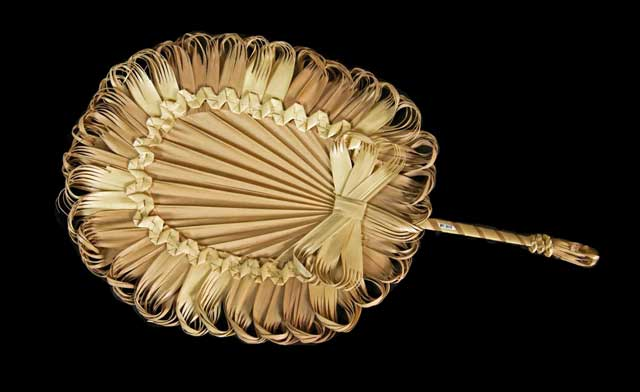 Palm frond fan from the early 1900s